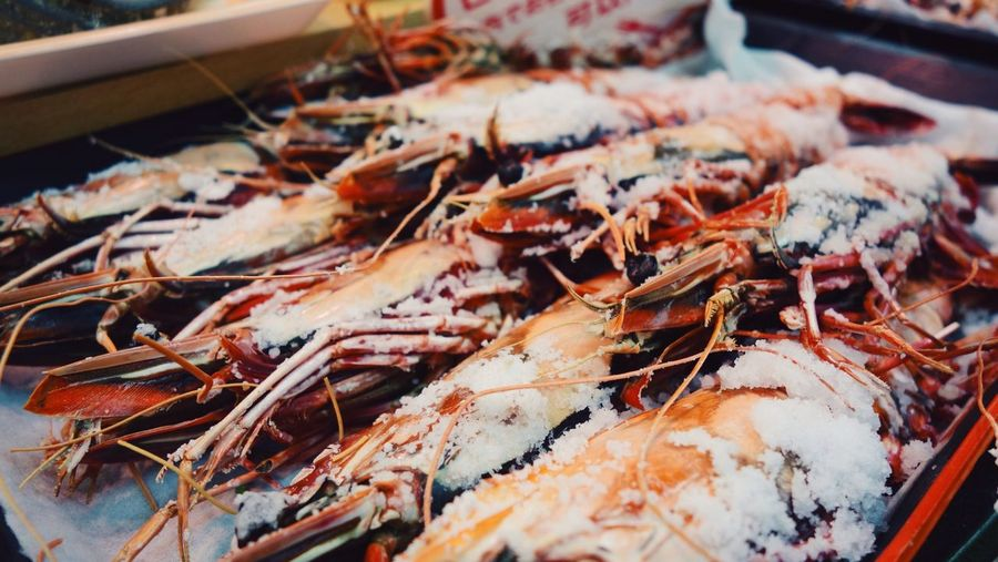 Close-up of prawns for sale at fish market