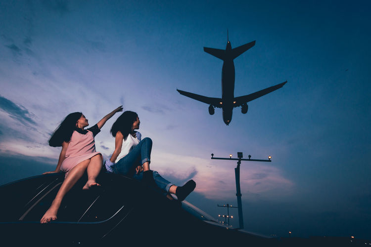 Sky Real People Mode Of Transportation Transportation Two People Lifestyles Women Togetherness Leisure Activity Nature People Young Women Sitting Men Cloud - Sky Air Vehicle Adult Young Adult Casual Clothing Child Outdoors