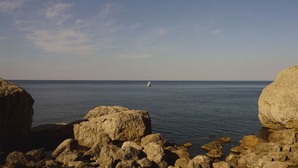 Beauty In Nature Day Horizon Over Water Nature No People Outdoors Rocks Scenics Sea Sky Tranquility Yawl