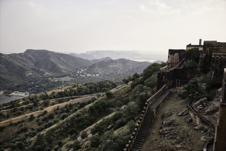High angle view of castle on mountain against sky in jaipur