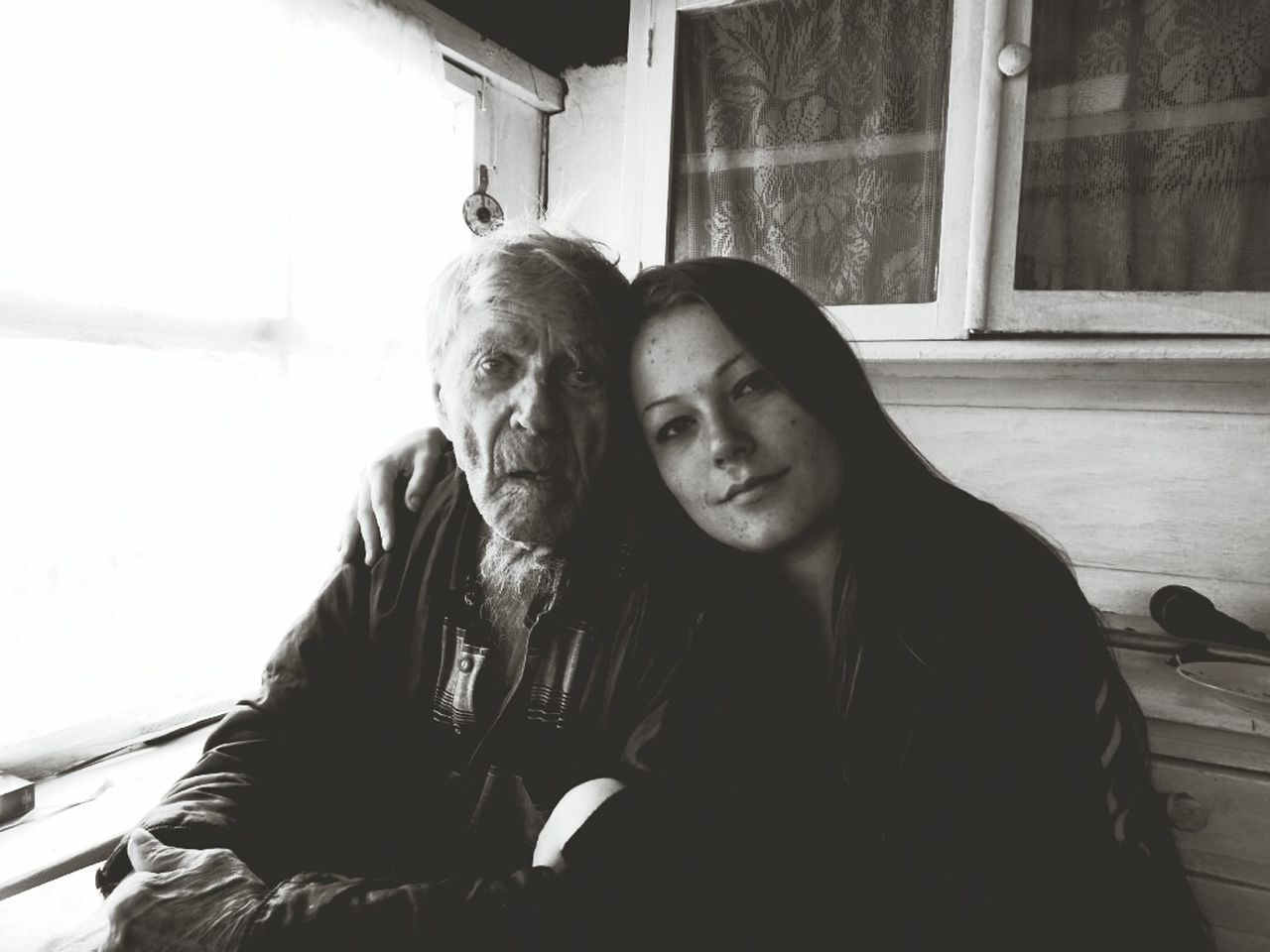 two people, senior adult, looking at camera, real people, senior women, senior men, portrait, togetherness, lifestyles, senior couple, love, day, sitting, outdoors, building exterior, bonding, women, young women, young adult