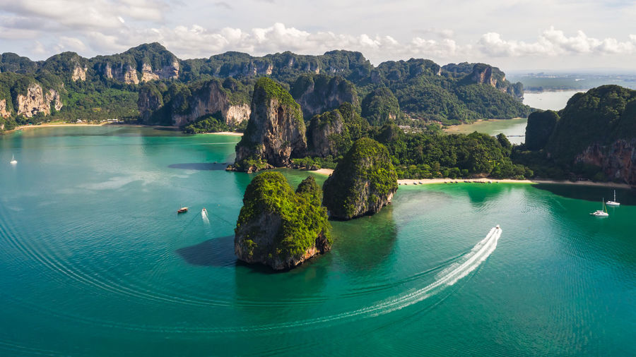 Scenic view of sea and mountains at aonang, railay, krabi, thailand