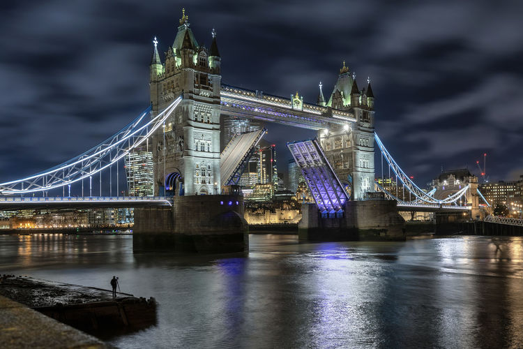 The lifted Tower Bridge in London by night Architecture Night Illuminated Bridge Bridge - Man Made Structure Travel Destinations City Sky River Cloud - Sky Water Chain Bridge Connection Built Structure London Tower Bridge  Tourist Attraction  Landmark Lifted Open Thames River Travel City Of London Lights Evening