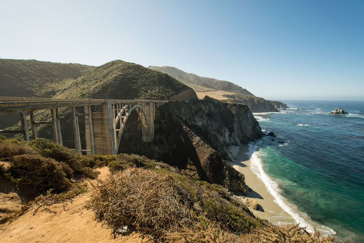 Scenic View Of Bixby Creek Bridge By Sea Against Sky At Big Sur