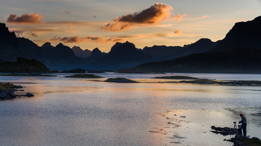 The photographer Lofoten Sunset Photographer Evening Dramatic Sky Landscape Clouds Water Mountains Reflection Beauty In Nature Tranquil Scene Sea Mountain Range Outdoors Idyllic Tranquility