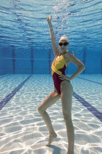 Full length of young woman in swimming pool