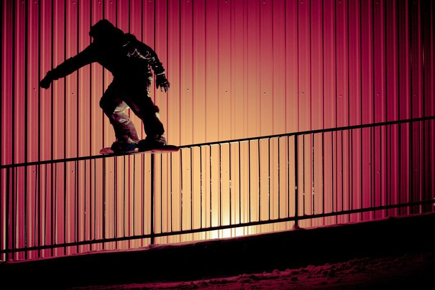 Colors and patterns Snowboarding in Newfoundland Nova Scotia > Simon Chamberlain slides away in the late night > Vertical lines everywhere > I lit the image to showcase the vertical lines and handrail, while keeping Simon as a silhouette figure > Novascotia Newfoundland Snowboarding Flashphotography Fun