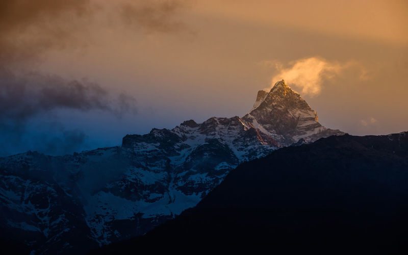 this Sunrise at Mount Fishtail, Pokhara, Nepal. this is very famous trekking route for view Mountain range of Nepal. Travel Destinations Mountain Peak Snowcapped Mountain Environment Idyllic Non-urban Scene Cold Temperature Mountain Range Tranquility Tranquil Scene Cloud - Sky Scenics - Nature Sunset Beauty In Nature Mountain Sky Winter Snow Nature No People Formation ASIA Nepal Nepal Travel Pokhara Eyeempokhara Eyeemnepal Winter, Cold, Icy, Calm, Cool, Clouds And Sky Foggy Holiday Outdoor, Landscape Sunrise, Sunrise_sunsets_aroundworld Gloomy Day Golden Golden Hour The Traveler - 2019 EyeEm Awards