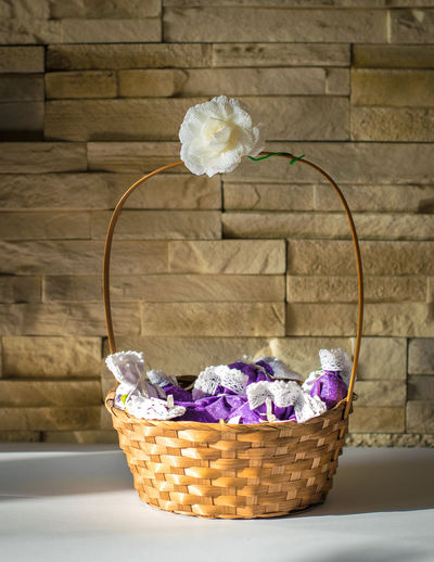 Wall Backgrounds Basket Brick Close-up Day Flower Flower Head Fragility Gift Indoors  Lavender No People Pattern Perfume Present Vertical Violet
