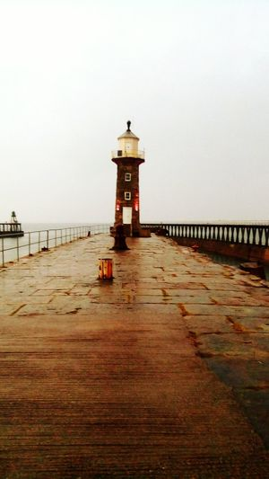 Whitby North Yorkshire Harbour Harbour View Whitby The Week On EyeEm Whitby Harbour Safety Lighthouse Sea Protection Beach Security Horizon Over Water Built Structure Water Building Exterior Architecture Sand Lifeguard  Lifeguard Hut Outdoors Tranquility No People Sky Scenics