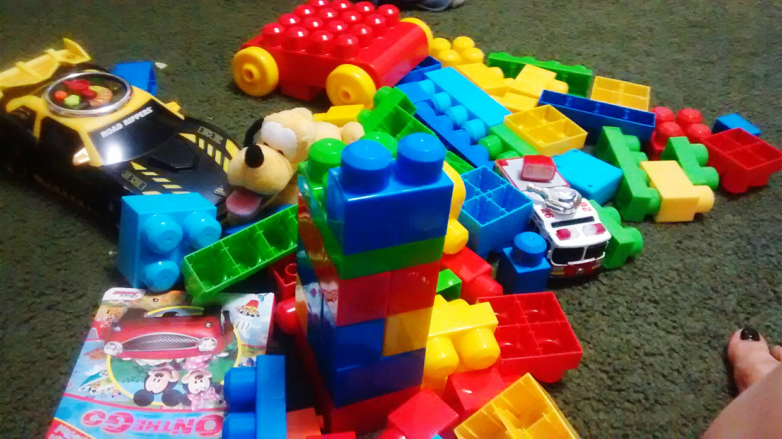 multi colored, high angle view, indoors, variation, childhood, large group of objects, leisure activity, toy, choice, lifestyles, table, colorful, leisure games, abundance, still life, fun, plastic, arrangement