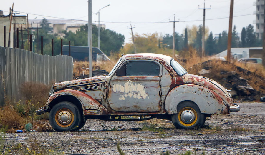 Side view of old car
