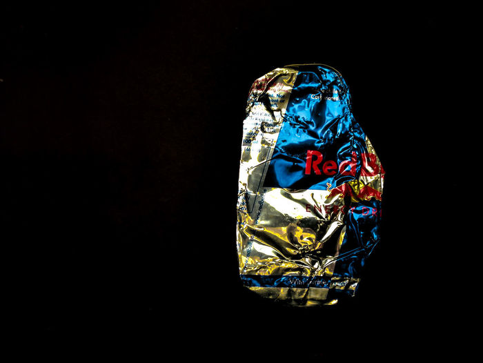 Red Bull Crumpled Food And Drink RedBull Aluminium Can Art And Craft Black Background Blue Close-up Copy Space Craft Creativity Indoors  Luxury Multi Colored No People Pattern Shiny Single Object Still Life Studio Shot Wealth