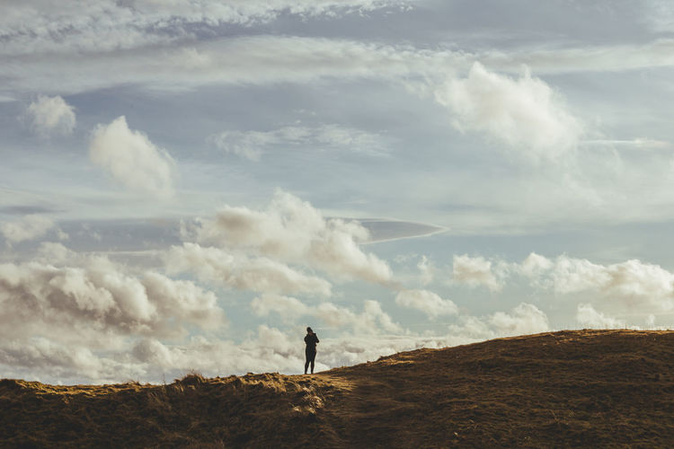 Man standing on land against sky