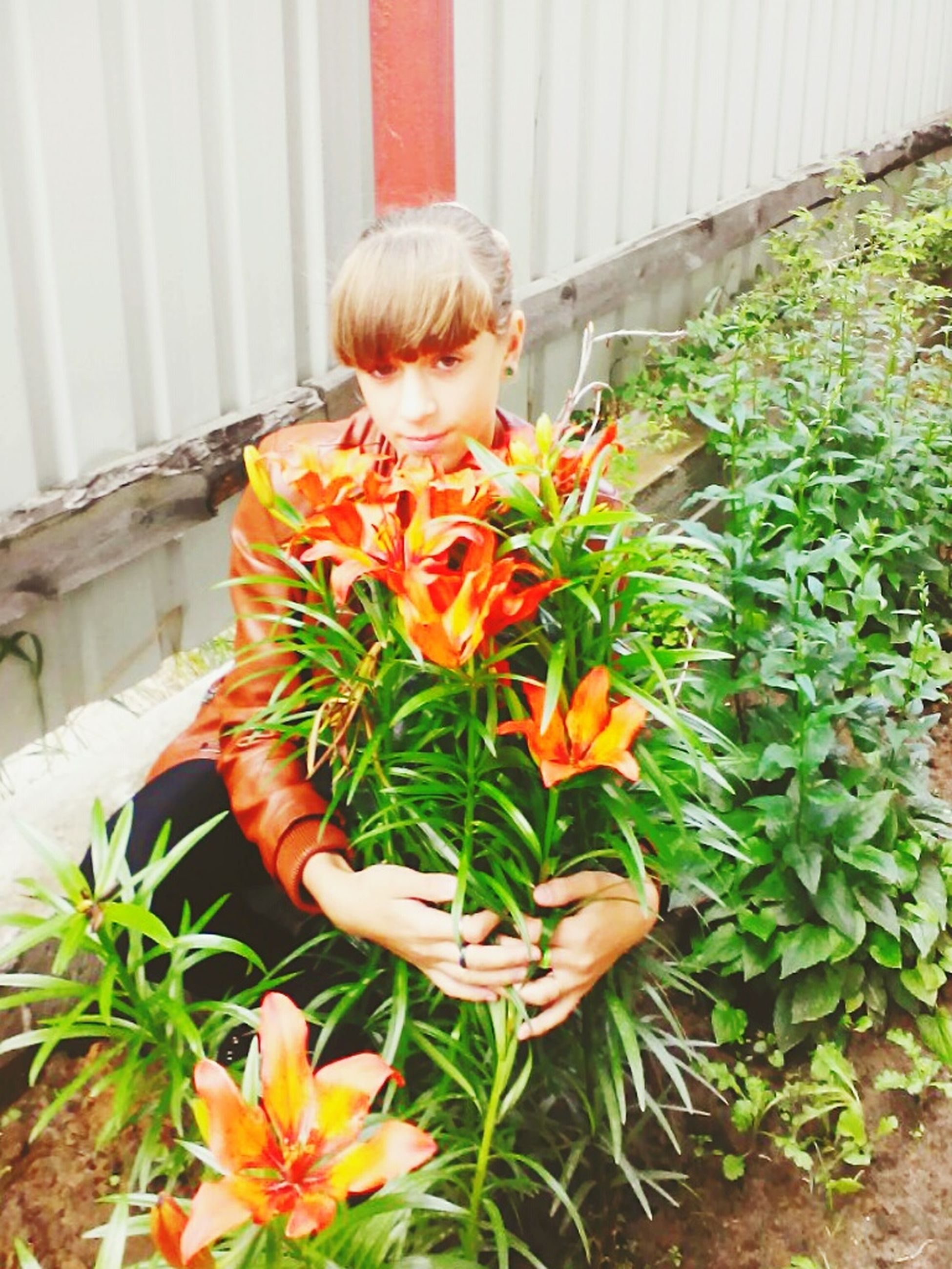 childhood, elementary age, flower, person, casual clothing, girls, innocence, lifestyles, leisure activity, boys, cute, holding, full length, plant, standing, freshness, fragility, front or back yard
