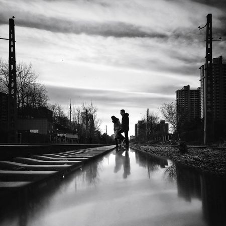 Cloud - Sky Sky Outdoors Day Architecture Tree Building Exterior Adult City Tranquil Scene Street Photography City Life Shadows & Lights Cityscape Beijing, China Light And Shadow Huawei P9 Photos Shadow Silhouette Black And White Low Angle View Railway Track Couple Mirrored Reflection Railroad Track