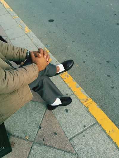 High angle view of man waiting at sidewalk