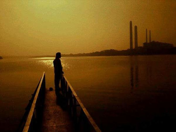 My first click Mobilephotography Sunset Alone Man Powerplant River Damside