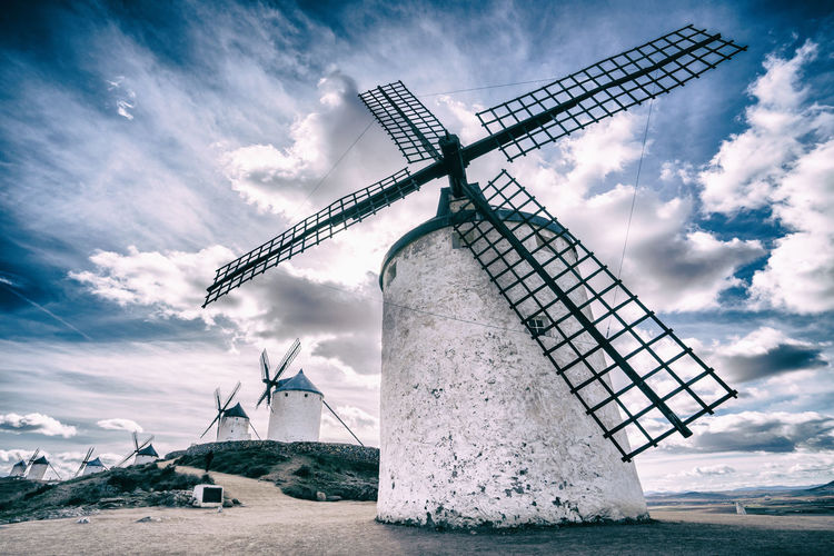 Consuegra, Spain Alternative Energy Architecture Beauty In Nature Cloud - Sky Day Environment Environmental Conservation Fuel And Power Generation Land Landscape Nature No People Outdoors Renewable Energy Rural Scene Sky Technology Traditional Windmill Turbine Water Wind Power Wind Turbine