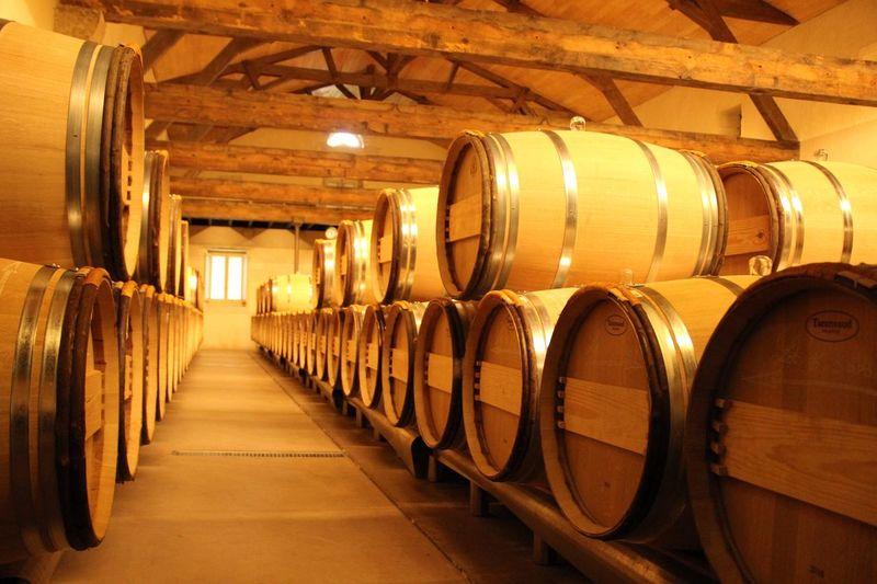 Barrels stacked in wine cellar