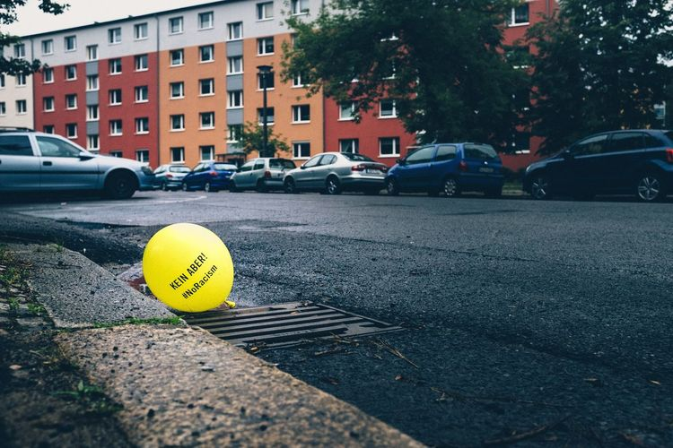 The Photojournalist - 2015 EyeEm AwardsKEIN ABER! Noracism Notes From Berlin Notes Balloon Streetphotography Street Streetart Political Society Remains of a demonstration against racism in BerlinMitte