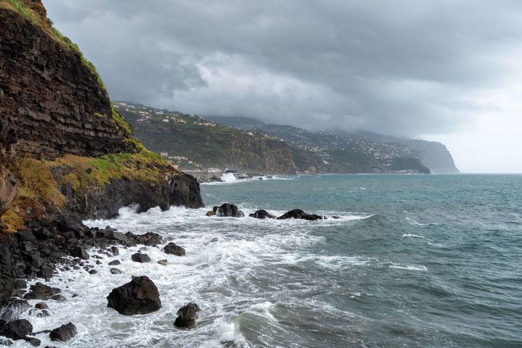 View of Ponta do Sol pier bridge in Madeira Autumn City Cloudy Madeira Nature Panorama Panoramic Portugal Portuguese Travel Aerial View Horizon Island Landscape Mountain Mountains Outdoors Ponta Do Sol Rocks Sea Seascape Storm Village Water Waves