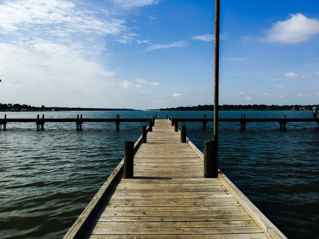 Eyeemphoto Showcase August Tranquil Scene Tranquility Pole Sky And Clouds Architecture Planks Wooden Diminshing Perspective Outdoors Boardwalk Blue Sky Blue Diminishing Perspective Lake Wood Sky Pier The Way Forward Summer Water