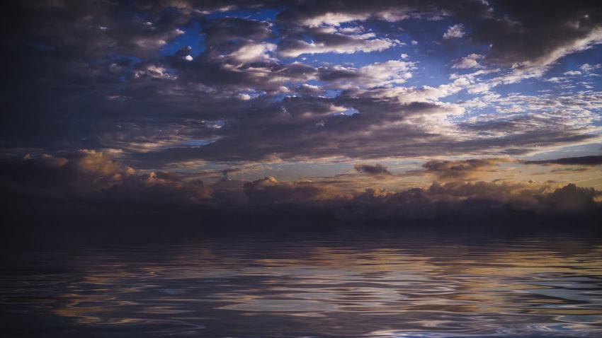 Dark dramatic sky over the ocean Beautiful Nature Cloudscape Dramatic Sky Beauty In Nature Cloud - Sky Clouds Clouds And Sky Dramatic Sky Horizon No People Ocean Reflection Sea Sky Sunset Water
