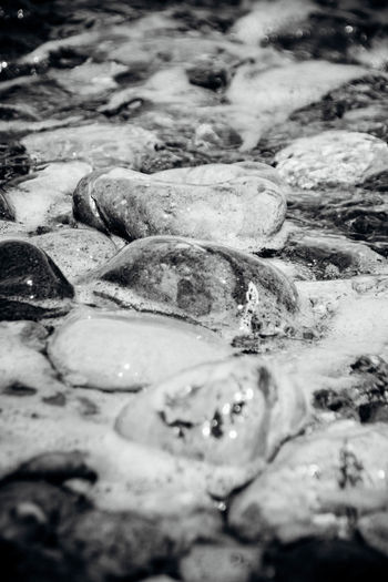 At Ground Level Backgrounds Beauty In Nature Close-up Large Group Of Objects Nature No People Pebbles Pebbles And Stones Pebbles And Water Rushing Water Scenics Sea Selective Focus Shore Tidal Tide Water