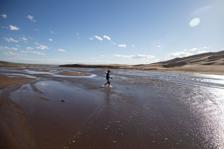 Boy walking at beach