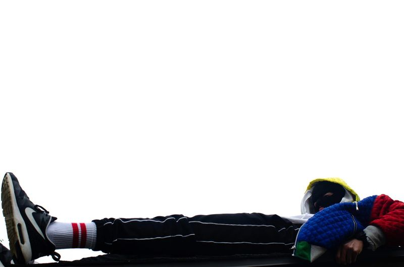 Rear view of people with toy against white background