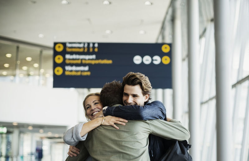 Affectionate business colleagues embracing at airport