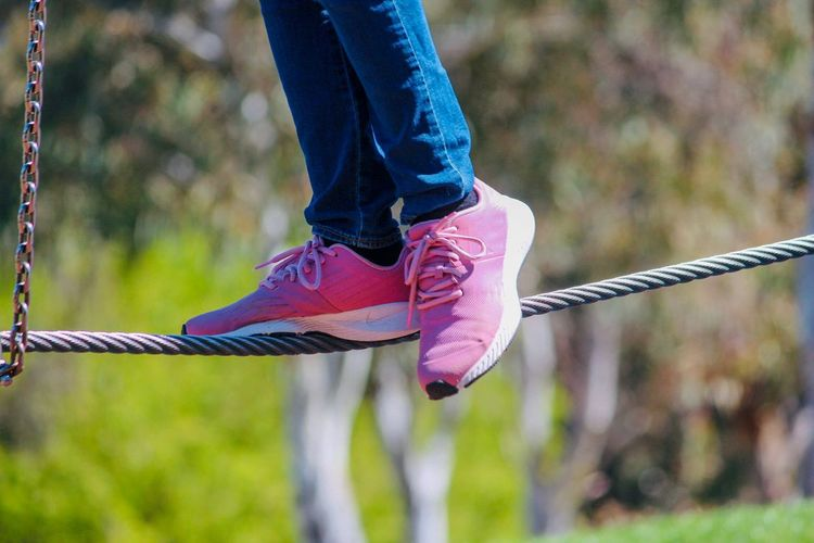 Child Playing Jeans Pink Sport Shoes Focus On Foreground Human Body Part Low Section Day Body Part One Person Human Leg Outdoors Lifestyles Nature Leisure Activity Rope Shoe Unrecognizable Person Casual Clothing Sunlight Human Limb Real People