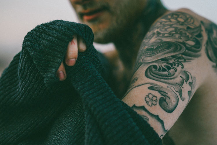 Adult Close-up Day Glove Human Body Part Human Hand Indoors  Leisure Activity Lifestyles Men One Person People Real People Tattooed Warm Clothing Women