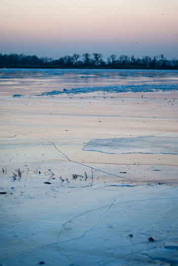 Frozen Odra river at dusk Ice River View Riverside Sunset_collection Winter Beauty In Nature Cold Temperature Cracked Dusk Fissure Floe Frozen Ice Covered  Landscape Nature No People Outdoors Rupture Scenics Snow Solid Sunset Tranquil Scene Tranquility Winter
