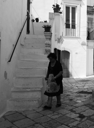 Full Length One Person Adult Blackandwhitephotography Black And White Photography Blackandwhite Photography One Woman One Woman Only Puglia, Italy Italy🇮🇹 Puglia South Italy Real People Locorotondo Day Architecture Built Structure