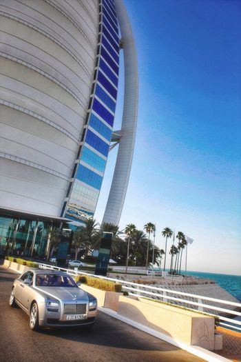 Luxury life..... Rolls Royce Burj Al Arab Dubai Luxury Hotel Sky Motor Vehicle Car Water Transportation Architecture Built Structure Nature Blue Beach Sunlight Sea Travel Destinations