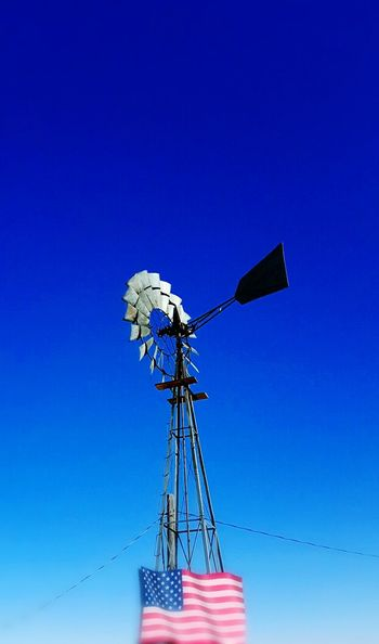 Windmill against blue sky North Of Lusk Wyoming Old Windmill Out In The Country Clear Blue Sky Beautiful Summer Morning United States No People