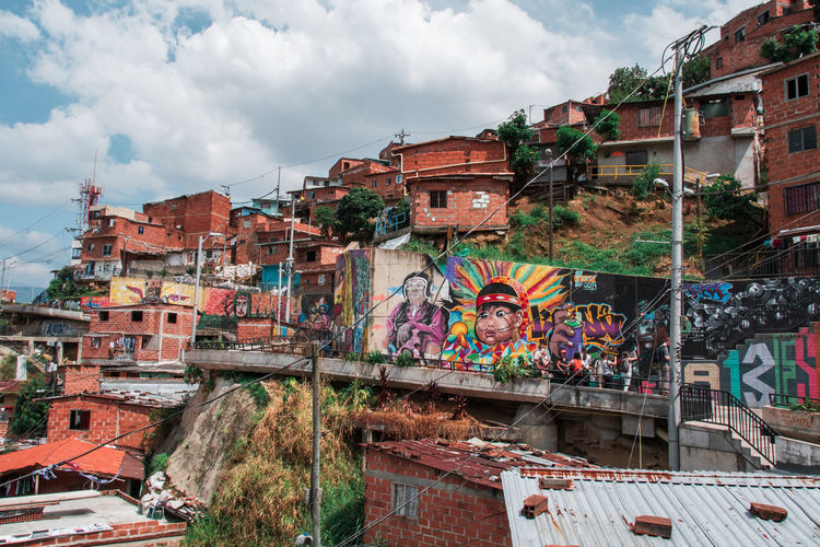 Medellin Colombia and the famous Comuna 13 Architecture Building Exterior Built Structure Building City Residential District Day Outdoors Cloud - Sky Sky Nature House No People Plant Multi Colored Graffiti Roof Old Mode Of Transportation Community Comuna 13 Comuna Colombia Slums Ghetto South America Streetphotography Art Grafitti Tele Cable