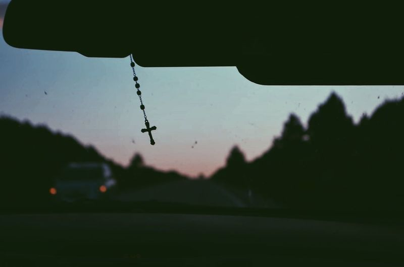 Cross On Rear View Mirror