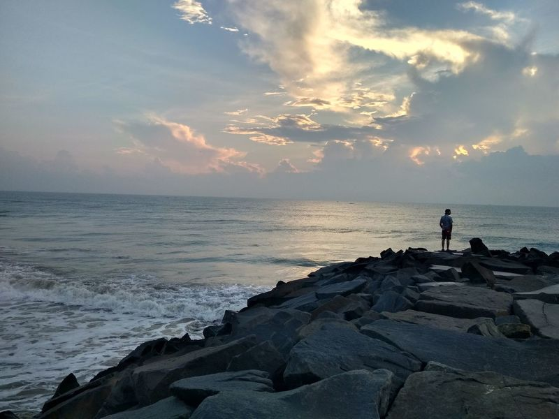 Sunrise Sky Heaven Horizon EyeEmNewHere Pondicherry Coast Ocean Peace Man Rocks Man In Sea Man On Rocks Water Sea Sunset Wave Beach Full Length Summer Silhouette Sun Tide Surf Surfer Pebble Beach Seascape This Is Masculinity