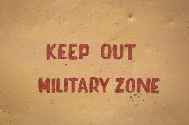 Close-up warning sign on wall