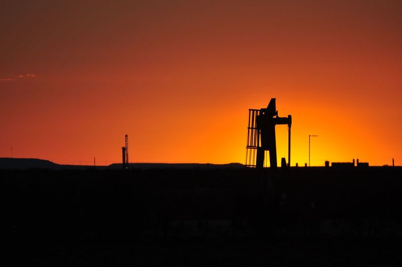 Sunset Silhouette Business Finance And Industry No People Sky Built Structure Landscape Nature Outdoors Day Texasphotographer Nikonphotographer Nikon Photography Sunsets_oftheworld West Texas Sunset Nikon Dslr Rural Scene Cloud - Sky This Week On Eye Em Dramatic Sky Oil Industry Pump Jack With Sun Setting Behind It Pump Jack Pump Jacks