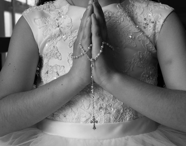 Communion CommunionPhotography Adult Bride Celebration Communication Event Hand Holy Communion Human Body Part Human Hand Indoors  Life Events Lifestyles Midsection Newlywed People Positive Emotion Praying Real People Religion Sitting Two People Wedding Women