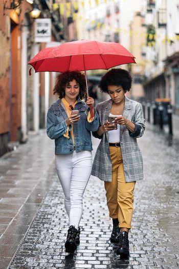 Woman with umbrella walking in rain