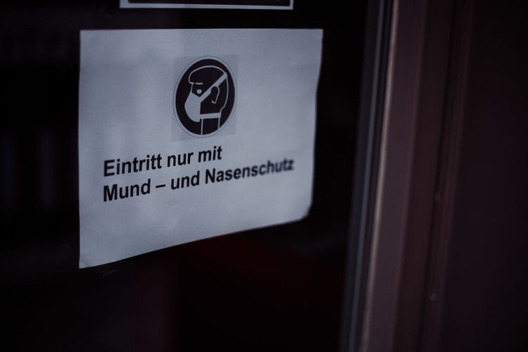 Close-up of warning sign on window