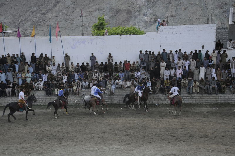 local people in Gilgit playing polo sports Group Of People Large Group Of People Real People Crowd Mammal Livestock Domestic Animals Domestic Horse Animal Wildlife Pets Group Of Animals Men Lifestyles Vertebrate Architecture Women Outdoors Polo
