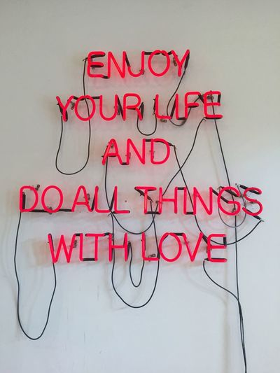 'Enjoy your life and do all thing with love' quote on white wall background Life Phase Neon Neon Lights Sentence Love Joyful Enjoy Inspiration Inspired Quote Quotes Sentence Text Communication No People Red Close-up