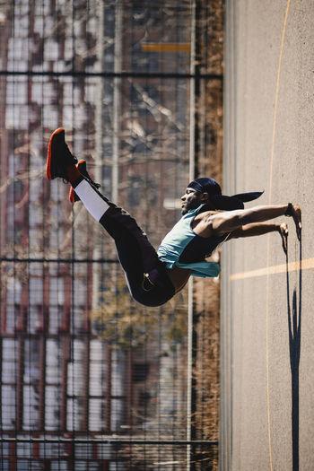 Full length of man skateboarding on wall