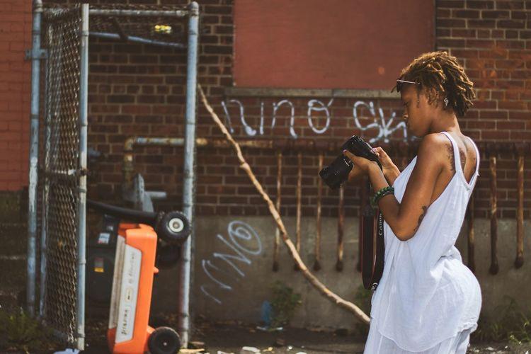 She's a photographer Bridgeport Connecticut 2015 City White Dress EyeEm Canon Artist Woman Working Natural Hair Black Woman Photographer Streetphotography